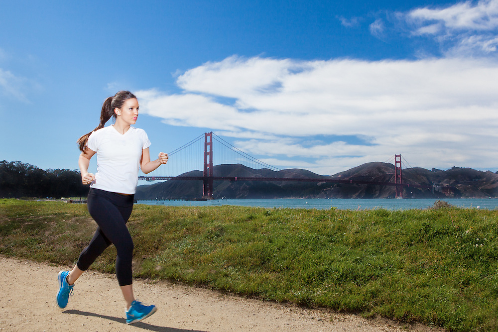 Lifestyle & Editorial Photography. Girl running in front of Golden Gate Bridge.