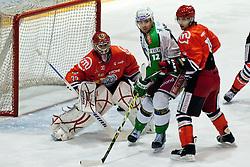 John Hughes (HDD Tilia Olimpija, #72) vs Marjan Manfreda (HK Acroni Jesenice, #18) and Michal Fikrt (HK Acroni Jesenice, #37)  during ice-hockey match between HK Acroni Jesenice and HDD Tilia Olimpija in 34th Round of EBEL league, on December 26, 2011 at Dvorana Podmezaklja, Jesenice, Slovenia. (Photo By Matic Klansek Velej / Sportida)