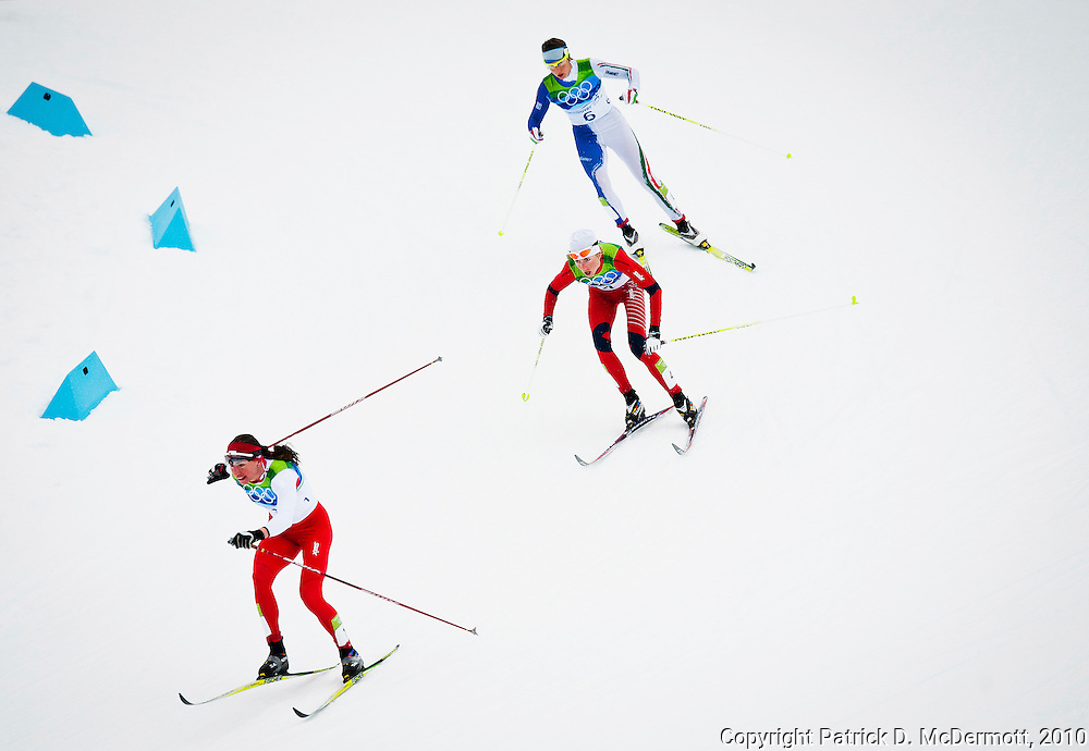 Justyna Kowalczyk, POL, leads Marit Bjoergen, NOR, and Marianna, ITA, in the women's cross-country skiing 30 KM mass start classic during the 2010 Vancouver Winter Olympics in Whistler, British Columbia, Saturday, Feb. 27, 2010. Canada defeated the United States 3-2 in overtime.