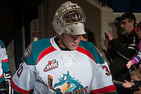 KELOWNA, CANADA - DECEMBER 27: Jordon Cooke #30 of the Kelowna Rockets walks to the ice for warm up against the Kamloops Blazers on December 27, 2013 at Prospera Place in Kelowna, British Columbia, Canada.   (Photo by Marissa Baecker/Shoot the Breeze)  ***  Local Caption  ***