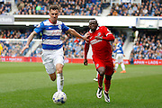 Queens Park Rangers defender Grant Hall (4) and Charlton Athletic striker Igor Vetokele (14) battle for the ball during the Sky Bet Championship match between Queens Park Rangers and Charlton Athletic at the Loftus Road Stadium, London, England on 9 April 2016. Photo by Andy Walter.