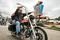 Jason Denbeston and Melissa Coons ride down the boulevard at Weirs Beach Sunday afternoon as Laconia's 93rd Motorcycle Rally gets under way.  (Karen Bobotas/for the Laconia Daily Sun)