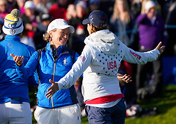 Auchterarder, Scotland, UK. 15 September 2019. Sunday final day at 2019 Solheim Cup on Centenary Course at Gleneagles. Pictured; Europe Captain Catriona Matthew commiserates with USA Captain Juli Inkster after Europe won the Solheim Cup on the 18th green. Iain Masterton/Alamy Live News