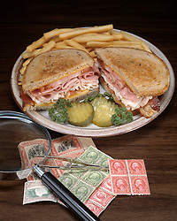 fast food sandwich platter ham cheese turkey tomato tomatoe patty melt french fry fries pickle slices Bon Appetit concept conceptual metaphor Cuisine stamp collectors items stamps magnifying class twezzers lifestyle travel Dine Entertaining Entice Enticing Fed Feed Feeding Flavor Flavorful Foodshot Fragrant Haute Gourmet Gourmand Good Gratify Gratifying Grocery Healthfood Hospitable Hospitality Ingredient Lunch Market Munchy Marketplace Natural Organic Portion Pretty Produce Refresh Refreshing Satisfying Satisfaction Seasonal Serve Serving Smell Still life