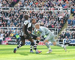 NEWCASTLE-UPON-TYNE, ENGLAND - Sunday, April 1, 2012: Liverpool's goalkeeper Jose Reina is fouled by Newcastle United's James Perch during the Premiership match at St James' Park. (Pic by David Rawcliffe/Propaganda)