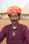Portrait of a young Indian man with turban and stylish moustache