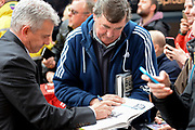 Nottingham Forest interim manager Gary Brazil signs a book for a Forest fan ahead of the EFL Sky Bet Championship match between Burton Albion and Nottingham Forest at the Pirelli Stadium, Burton upon Trent, England on 11 March 2017. Photo by Jon Hobley.