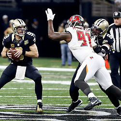 Dec 24, 2016; New Orleans, LA, USA; New Orleans Saints quarterback Drew Brees (9) is pressured by Tampa Bay Buccaneers defensive end Robert Ayers (91) during the first quarter of a game at the Mercedes-Benz Superdome. Mandatory Credit: Derick E. Hingle-USA TODAY Sports