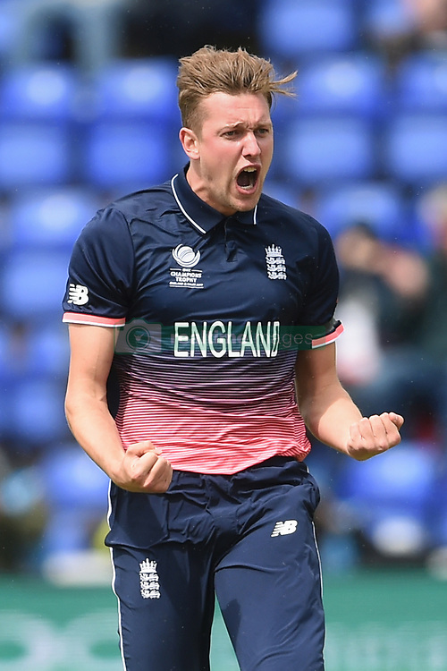 England's Jake Ball celebrates taking the wicket of New Zealand's Luke Ronchi during the ICC Champions Trophy, Group A match at Cardiff Wales Stadium.