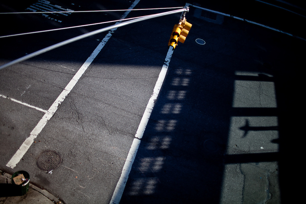 A child casts his shadow onto the street below from a viewing platform on the High Line, New York.