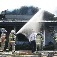 Firefighters from Saltillo, Birmingham Ridge, Guntown and others from nearby stations work to put out a blaze at Doggie Do's on Mobile Street in Saltillo on Wednesday afternoon.
