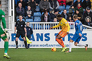 Gozie Ugwu (Forward) of Wycombe Wanderers on the wing watched by Hartlepool United midfielder Nicky Featherstone during the Sky Bet League 2 match between Hartlepool United and Wycombe Wanderers at Victoria Park, Hartlepool, England on 16 January 2016. Photo by George Ledger.