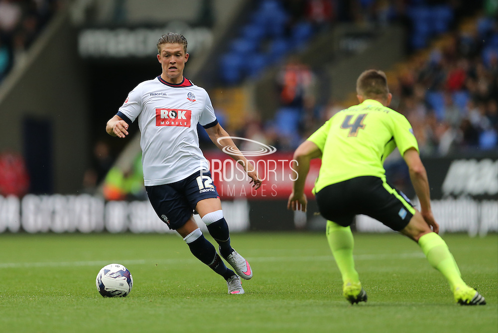 Bolton Wanderers striker Max Clayton takes on Brighton defender, Uwe Huenemeierduring the Sky Bet Championship match between Bolton Wanderers and Brighton and Hove Albion at the Macron Stadium, Bolton, England on 26 September 2015.