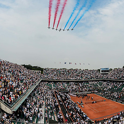 A general view as planes of the french patrol fly above court Philippe Chatrier, leaving the colours of the French flag, prior to the mens singles final between Rafael Nadal of Spain and Dominic Thiem of Austria during Day 15 for the French Open 2018 on June 10, 2018 in Paris, France. (Photo by Baptiste Fernandez/Icon Sport)