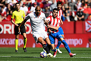 Steven N'zonzi of Sevilla FC under the pressure of the player of the Sporting during the Spanish championship Liga football match between Sevilla FC and Sporting Gijon on April 2, 2017 at Sanchez Pizjuan stadium in Sevilla, Spain - photo Cristobal Duenas / Spain / ProSportsImages / DPPI