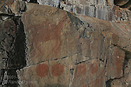 Centuries-old Ojibwe pictograph of mythological creatures is one of several story scenes that adorn Agawa Rock in Lake Superior Provincial Park, Ontario; Canada.