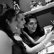 Ariel Zavala, top, looks at a cellphone with friends, middle, and Natalie Mosquera while having dinner at Hamburger Mary's Saturday, April 30, 2016 in Clearwater. Zavala who is transitioning from male to female attended her prom for Alonso High School on Saturday. CHRIS URSO/STAFF