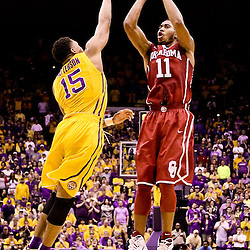 Jan 30, 2016; Baton Rouge, LA, USA; Oklahoma Sooners guard Isaiah Cousins (11) shoots over LSU Tigers guard Jalyn Patterson (15) during the second half of a game at the Pete Maravich Assembly Center. Oklahoma defeated LSU 77-75. Mandatory Credit: Derick E. Hingle-USA TODAY Sports