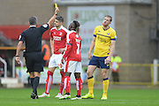 Scunthorpe United striker Kevin van Veen (right) gets a yellow card during the Sky Bet League 1 match between Swindon Town and Scunthorpe United at the County Ground, Swindon, England on 14 November 2015. Photo by Mark Davies.