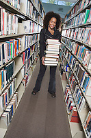 College Student with a Stack of Books