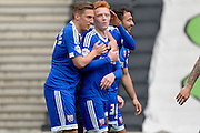 The Bees celebrate with scorer Brentford midfielder Ryan Woods during the Sky Bet Championship match between Milton Keynes Dons and Brentford at stadium:mk, Milton Keynes, England on 23 April 2016. Photo by Dennis Goodwin.