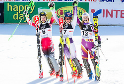"""Second placed Zettel Kathrin (AUT), winner Shiffrin Mikaela (USA) and third placed Loeseth Nina (NOR) celebrate in finish area after the FIS Alpine Ski World Cup 2014/15 5th Ladies' Slalom race named """"Snow Queen Trophy 2015"""", on January 4, 2015 in Course Crveni Spust at Sljeme hill, Zagreb, Croatia.  Photo by Vid Ponikvar / Sportida"""