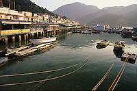 Shops and moored boats on Sok Kwu Wan Bay, Lamma Island, Hong Kong, China..