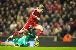 LIVERPOOL, ENGLAND - Wednesday, December 16, 2009: Liverpool's Fernando Torres rounds Wigan Athletic's Chris Kirkland to score his side's second goal during the Premiership match at Anfield. This was Torres' 100th appearance for Liverpool and his 49th goal.(Photo by: David Rawcliffe/Propaganda)