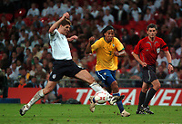 Photo: Tony Oudot.<br /> England v Brazil. International Friendly. 01/06/2007.<br /> Steven Gerrard of England tackles Ronaldinho of Brazil