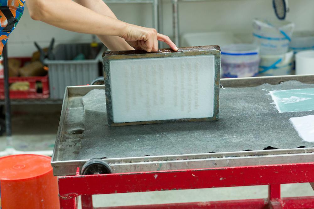 Sandra Erbacher cut text out of a sheet of vinyl using a laser cutter to create a watermark.