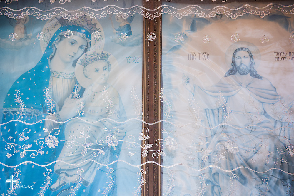 Fabric-draped paintings welcome visitors to the Entoto Maryam Church, on the foot of Mount Entoto in Addis Ababa, Ethiopia, on Sunday, Nov. 9, 2014. LCMS Communications/Erik M. Lunsford