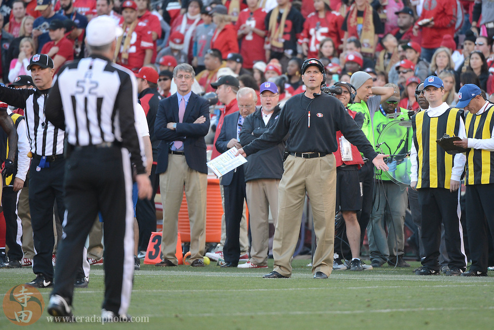 December 1, 2013; San Francisco, CA, USA; San Francisco 49ers head coach Jim Harbaugh (right) reacts at referee Bill Vinovich (52) after a fumble by running back Frank Gore (21, not pictured) against the St. Louis Rams during the third quarter at Candlestick Park. The 49ers defeated the Rams 23-13.