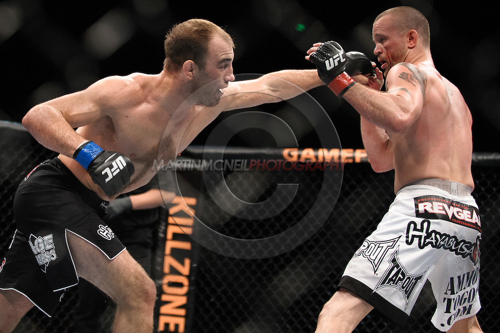 "SYDNEY, AUSTRALIA, FEBRUARY 27, 2011: Brian Ebersole (left) throws a lunging jab at Chris Lytle during ""UFC 127: Penn vs. Fitch"" inside Acer Arena in Sydney, Australia on February 27, 2011."