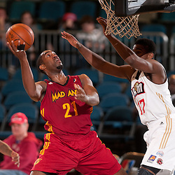 RENO, NV - JANUARY 9:  Darnell Lazare #21 of the Fort Wayne Mad Ants shoots around defender Osiris Eldridge #17 of the Bakersfield Jam during the 2012 NBA D-League Showcase inside the Reno Events Center in Reno, Nev., Monday, Jan. 9, 2012.  NOTE TO USER: User expressly acknowledges and agrees that, by downloading and or using this photograph, User is consenting to the terms and conditions of the Getty Images License Agreement. Mandatory Copyright Notice: Copyright 2012 NBAE  (Photo by David Calvert/NBAE via Getty Images) *** Local Caption *** Darnell Lazare;Osiris Eldrdge