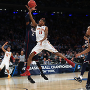 Monte Morris, Iowa, drives to the basket while defended by DeAndre Daniels, Connecticut, during the Iowa State Cyclones Vs Connecticut Huskies basketball game during the 2014 NCAA Division 1 Men's Basketball Championship, East Regional at Madison Square Garden, New York, USA. 28th March 2014. Photo Tim Clayton