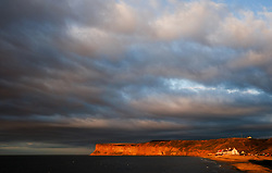 © Licensed to London News Pictures.06/08/15<br /> Saltburn, UK. <br /> <br /> The evening sun lights up the cliffs of Huntcliff at sunset at Saltburn by the Sea in Cleveland. <br /> <br /> Photo credit : Ian Forsyth/LNP