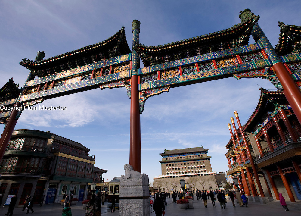 Ornate traditional Chinese gate with Zhengyangmen gate to rear at newly rebuilt Qianmen Street in Beijing 2009