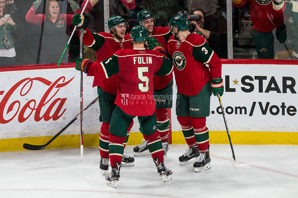Dec 29, 2016; Saint Paul, MN, USA; Minnesota Wild forward Nino Niederreiter (22), defenseman Marco Scandella (6), defenseman Christian Folin (5) and forward Charlie Coyle (3) celebrate a goal scored by forward Erik Haula (not pictured) during the third period against the New York Islanders at Xcel Energy Center. The Wild defeated the Islanders 6-4. Mandatory Credit: Brace Hemmelgarn-USA TODAY Sports