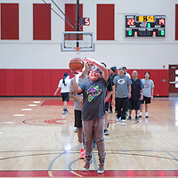 Lynelle Coan, 10, from Iyanbito plays a game of knockout during halftime of the faculty and staff basketball game between Navajo Technical University and Diné College, Saturday, Feb. 2 at NTU in Crownpoint. Coan travelled with her family to watch her aunt and grandma play.