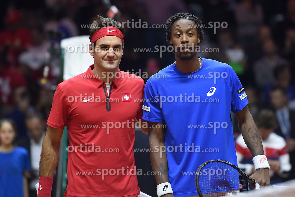 21.11.2014, Stade Pierre Mauroy, Lille, FRA, Davis Cup Finale, Frankreich vs Schweiz, im Bild Roger Federer (SUI) und Gael Monfils (FRA) // during the Davis Cup Final between France and Switzerland at the Stade Pierre Mauroy in Lille, France on 2014/11/21. EXPA Pictures &copy; 2014, PhotoCredit: EXPA/ Freshfocus/ Valeriano Di Domenico<br /> <br /> *****ATTENTION - for AUT, SLO, CRO, SRB, BIH, MAZ only*****