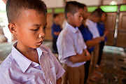 """Sept. 24, 2009 -- PATTANI, THAILAND: Thai schoolboys pray in the Krue Se Mosque in Pattani, Thailand. The Krue Se Mosque is one of Thailand's most historic mosques and long a flash point in Muslim - Buddhist confrontation. The mosque was first destroyed by advancing Thais when Pattani was an independent kingdom in 1786. It was restored in the 1980's but heavily damaged by rockets fired by unknown assailants in 2005. It has since been partially restored by local Muslims and the Thai government. Thailand's three southern most provinces; Yala, Pattani and Narathiwat are often called """"restive"""" and a decades long Muslim insurgency has gained traction recently and nearly 4,000 people have been killed since 2004. The three southern provinces are under emergency control and there are more than 60,000 Thai military, police and paramilitary militia forces trying to keep the peace battling insurgents who favor car bombs and assassination.    Photo by Jack Kurtz / ZUMA Press"""