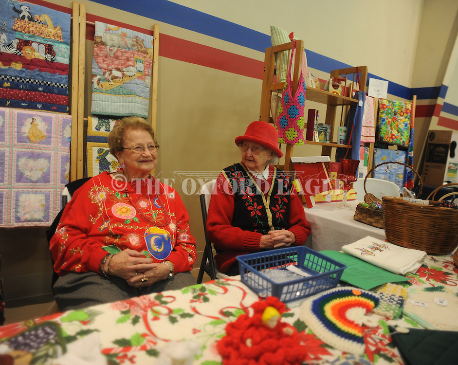 Mildred Knight (left) and Kathryn Leggitt work the Yocona Homemakers Club's booth during the annual Mississippi Homemakers Volunteers' Holiday House at North Oxford Baptist Church's activity center, in Oxford, Miss. on Friday, October 24, 2014.