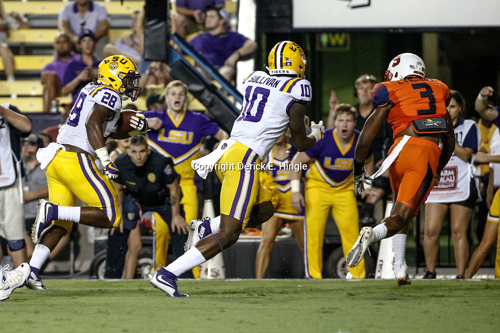 Sep 23, 2017; Baton Rouge, LA, USA; LSU Tigers running back Darrel Williams (28) runs for a touchdown against the Syracuse Orange during the third quarter of a game at Tiger Stadium. Mandatory Credit: Derick E. Hingle-USA TODAY Sports