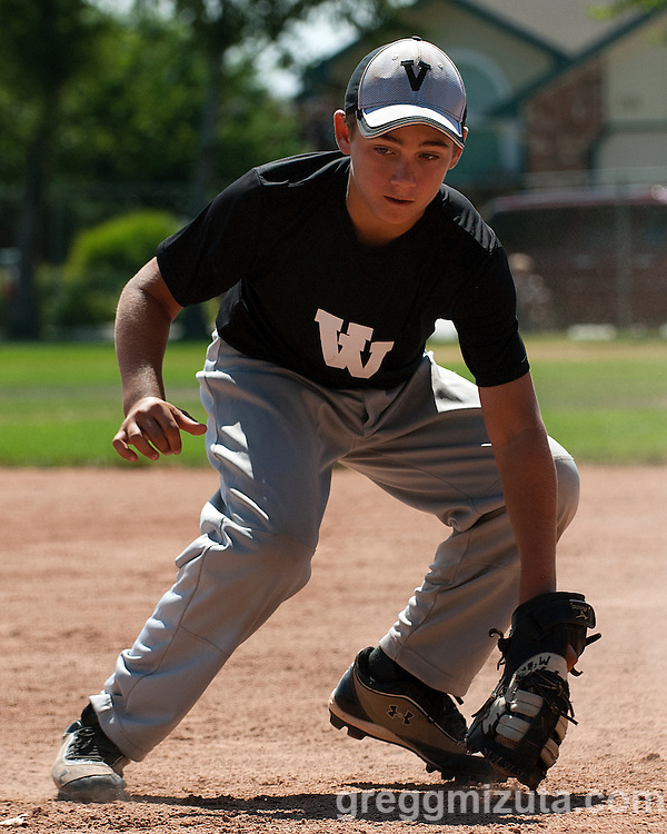 Matthew McBride fields a grounder during the Snake River Slug Fest Baseball Tournament at Mesa Recreation Park in Fruitland, Idaho on July 27, 2013.
