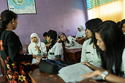 May 02, 2014 - Kendal, Indonesia. Tutik's daughter, Ika at school. During the three years her mother has been working in Singapore she has been able to see her once for 24hrs. © Nicolas Axelrod / Ruom