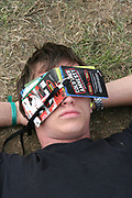 Festival goer chilling out at Reading, UK 2006