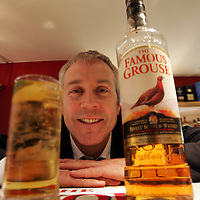Derek Brown of The Famous Grouse Experience pictured in the bar at the Famous Grouse Experience, where Derek conducts sessions of his Passport to Success programme which has been shortlisted for an award.<br />For further info contact Caorl McLaren/Edrington Group on 01738 493777<br />Picture by Graeme Hart.<br />Copyright Perthshire Picture Agency<br />Tel: 01738 623350  Mobile: 07990 594431