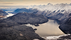 Chilkat Lake is located between Takhin Ridge (right) and the Chilkat River (left). In the distance (upper left) is the Chilkat Peninsula where the town of Haines is located. The tallest peak (center right) is Mount Emmerich. While a portion (foreground area) of Chilkat Lake is located in the Alaska Chilkat Bald Eagle Preserve, most of the preserve is located on the Chilkat River.