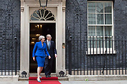 UNITED KINGDOM, London: 04 June 2019 <br /> The British Prime Minister Theresa May and her husband Philip walk out of No 10 Downing Street to welcome The President of the United States of America Donald Trump with his wife Melania during The President's official state visit.