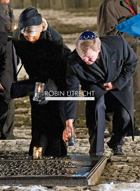 27-1- 2015 AUSCHWITZ -  King Willem Alexander and Queen Maxima from the Netherlands  are laying a candle at the monument in Camp Birkenau  during the the 70 years commemoration in Camp Auschwitz II Birkenau  in poland . COPYRIGHT ROBIN UTRECHT